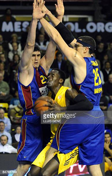 Barcelona's Ersan Ilyasova and Daniel Santiago vie with Alba Berlin´s Ansu Sesay during their Euroleague Basketball match on February 12 2009 at the...