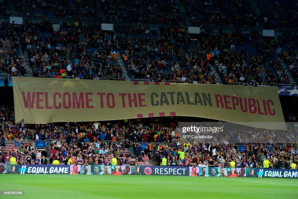 Barcelona's fans display a giant banner reading 'Welcome to the Catalan Republic' before the UEFA Champions League Group D football match FC Barcelona vs Juventus at the Camp Nou stadium in Barcelona on September 12, 2017. / AFP PHOTO / Josep LAGO