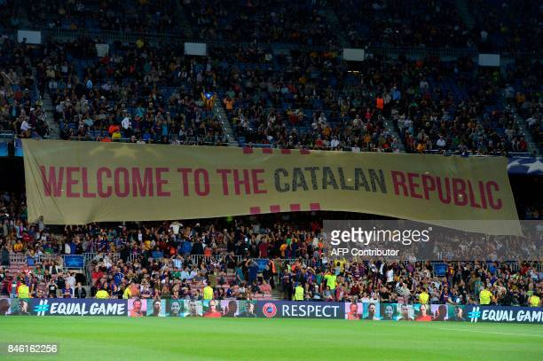 Barcelona's fans display a giant banner reading 'Welcome to the Catalan Republic' before the UEFA Champions League Group D football match FC...