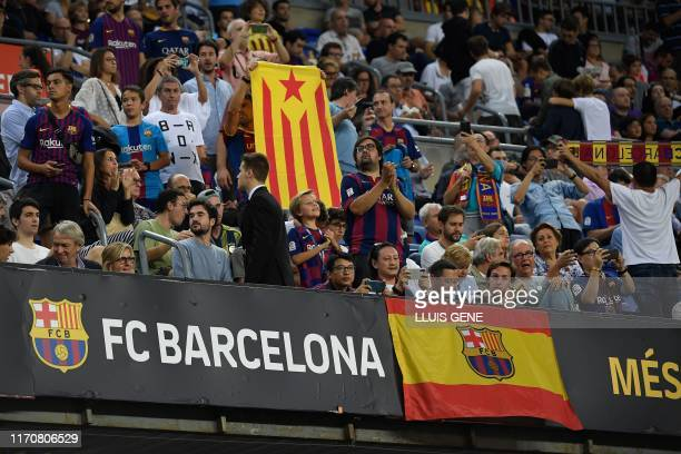"""Barcelona's fans hold a team's flag and a Catalan pro-independence """"Estelada"""" flag on the stands, during the Spanish league football match between FC..."""