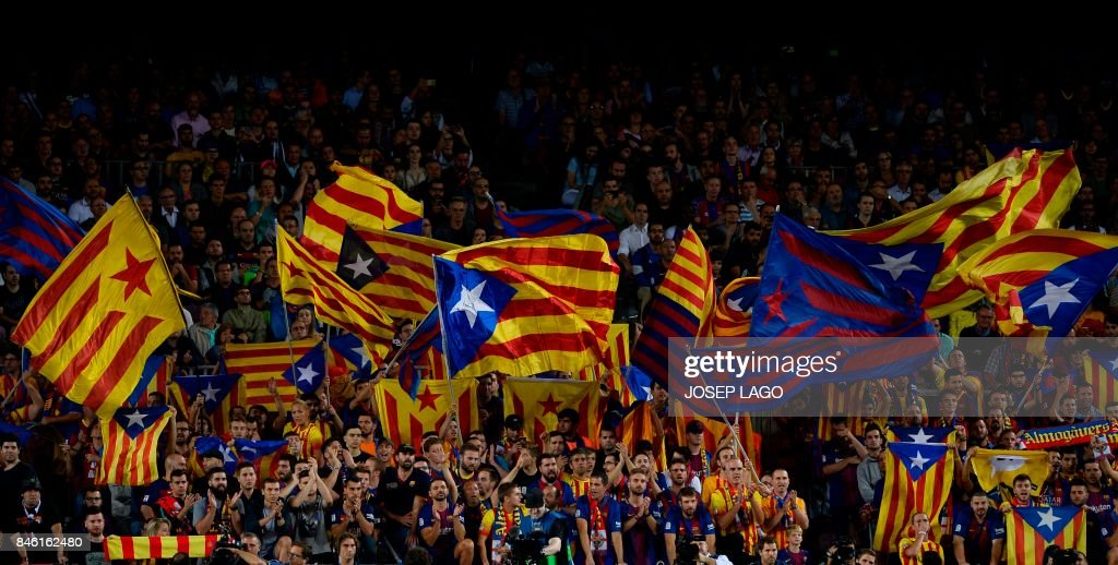 Barcelona's fans wave 'Esteladas' (pro-independence Catalan flags) before the UEFA Champions League Group D football match FC Barcelona vs Juventus at the Camp Nou stadium in Barcelona on September 12, 2017. / AFP PHOTO / Josep LAGO