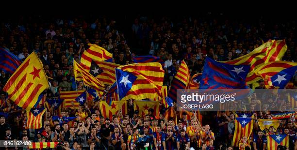 Barcelona's fans wave 'Esteladas' before the UEFA Champions League Group D football match FC Barcelona vs Juventus at the Camp Nou stadium in...