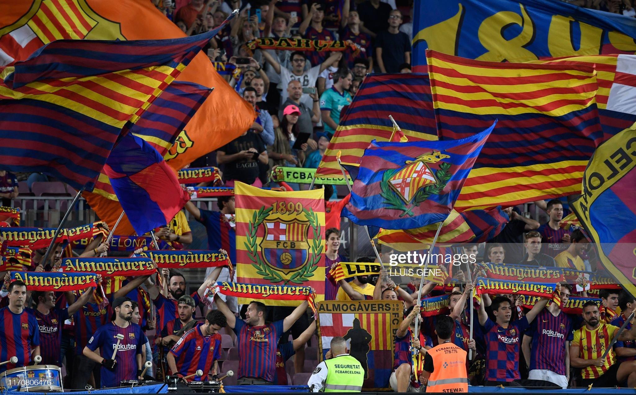 صور مباراة : برشلونة - فياريال 2-1 ( 24-09-2019 )  Barcelonas-fans-wave-teams-flags-and-cheer-from-the-stands-during-the-picture-id1170806476?s=2048x2048