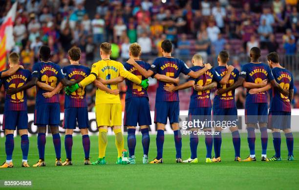 Barcelona's football players observe a minute of silence as they wear jerseys reading Barcelona instead of their names to pay tribute to the victims...
