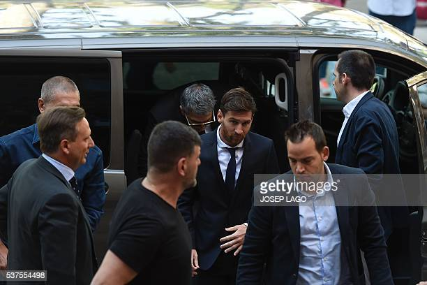 Barcelona's football star Lionel Messi followed by his father Jorge Horacio Messi arrives at the courthouse on June 2 2016 in Barcelona where Messi...