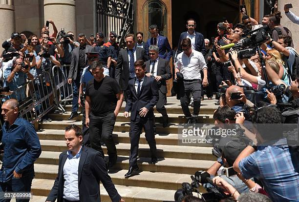 Barcelona's football star Lionel Messi followed by his father Jorge Horacio Messi and his brother Rodrigo Messi leaves the courthouse on June 2 2016...