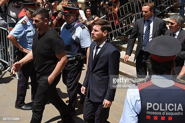 Barcelona's football star Lionel Messi followed by his father Jorge Horacio Messi leaves the courthouse on June 2 2016 in Barcelona where Messi and...