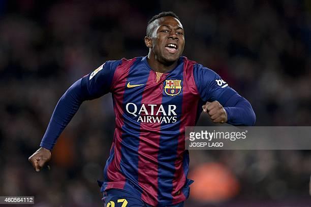 Barcelona's forward Adama celebrates his goal during the Spanish Copa del Rey round of 32 second leg football match FC Barcelona vs SAD Huesca at the...