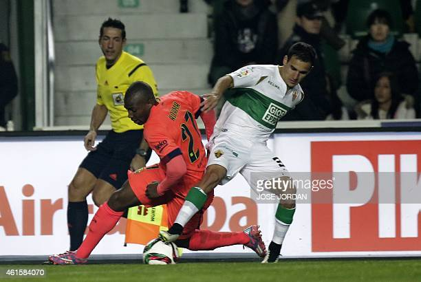 Barcelona's forward Adama Traore vies with Elche's Argentinian forward Franco Fragapane during the Spanish Copa del Rey round of 16 second leg...