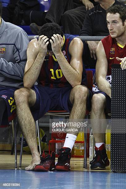 Barcelona's forward Alejandro Abrines sits wearing only one shoe during the Euroleague group C basketball match FC Barcelona vs Fenerbahce Ulker...