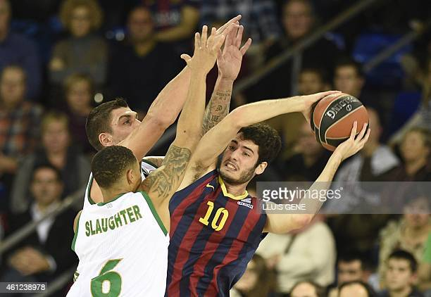 Barcelona's forward Alex Abrines vies with Panathinaikos Athens' guard AJ Slaugther during the Euroleague basketball match FC Barcelona vs...