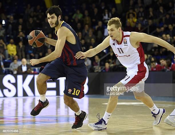 Barcelona's forward Alex Abrines vies with Red Star Belgrade's Slovenian guard Jaka Blazic during the Euroleague round 4 basketball match FC...