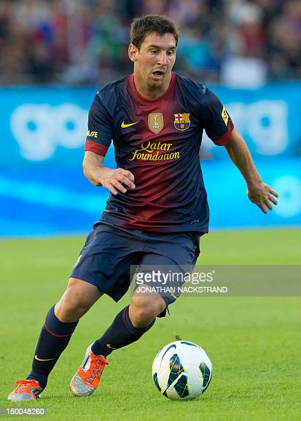 Barcelona's forward Argentinian Lionel Messi controls the ball during the friendly football match between Manchester United and FC Barcelona at the...