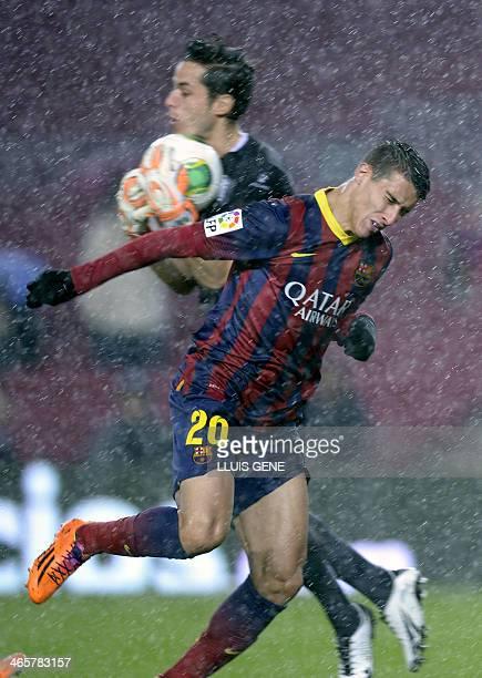 Barcelona's forward Cristian Tello vies with Levante's goalkeeper Javi Jimenez during the Spanish Copa del Rey quarterfinal secondleg football match...