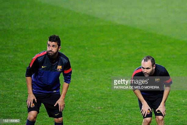 Barcelona's forward David Villa and midfielder Andres Iniesta attend a training session at Luz Stadium in Lisbon on October 1 on the eve of their...