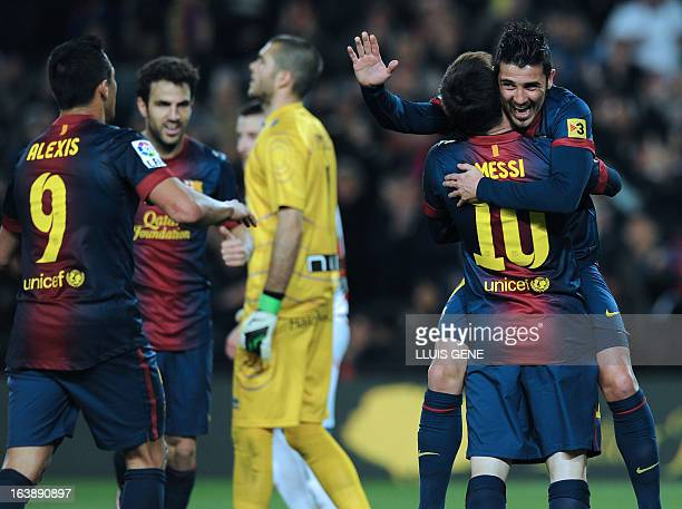 Barcelona's forward David Villa celebrates with Barcelona's Argentinian forward Lionel Messi and Barcelona's Chilean forward Alexis Sanchez after...