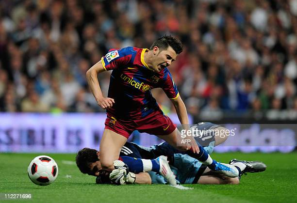 Barcelona's forward David Villa vies with Real Madrid's goalkeeper and captain Iker Casillas during 'El Clasico' Spanish League football match Real...