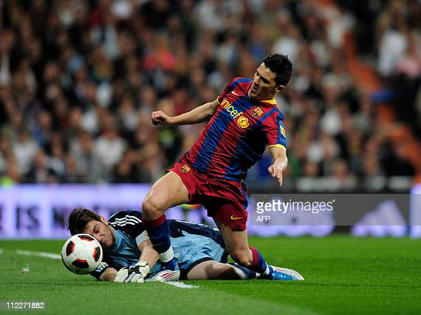 Barcelona's forward David Villa vies with Real Madrid's goalkeeper and captain Iker Casillas during the 'El Clasico' Spanish League football match...