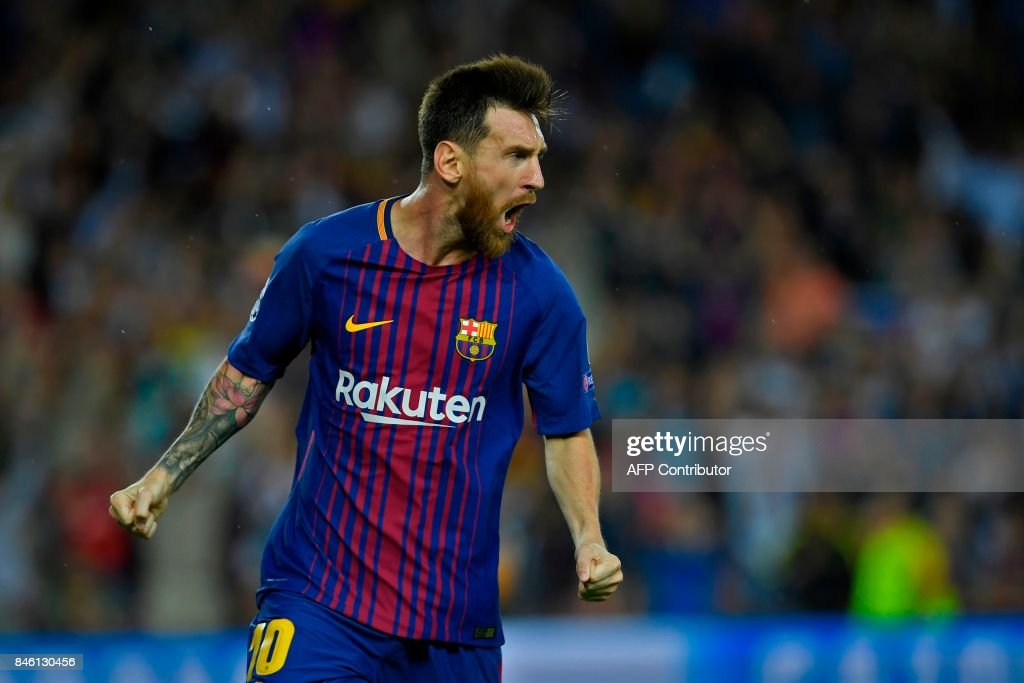TOPSHOT - Barcelona's forward from Argentina Lionel Messi celebrates after scoring during the UEFA Champions League Group D football match FC Barcelona vs Juventus at the Camp Nou stadium in Barcelona on September 12, 2017. /