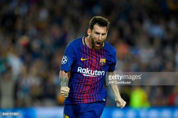 TOPSHOT Barcelona's forward from Argentina Lionel Messi celebrates after scoring during the UEFA Champions League Group D football match FC Barcelona...