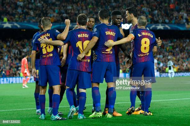 Barcelona's forward from Argentina Lionel Messi celebrates with teammates after scoring during the UEFA Champions League Group D football match FC...