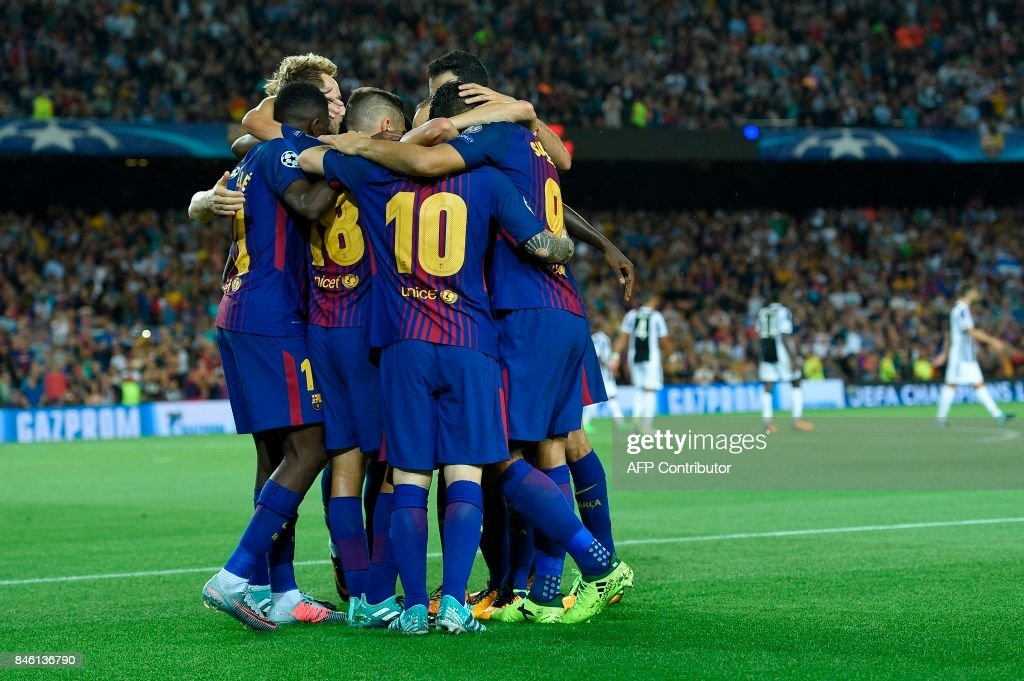 Barcelona's forward from Argentina Lionel Messi (10) celebrates with teammates after scoring during the UEFA Champions League Group D football match FC Barcelona vs Juventus at the Camp Nou stadium in Barcelona on September 12, 2017. /