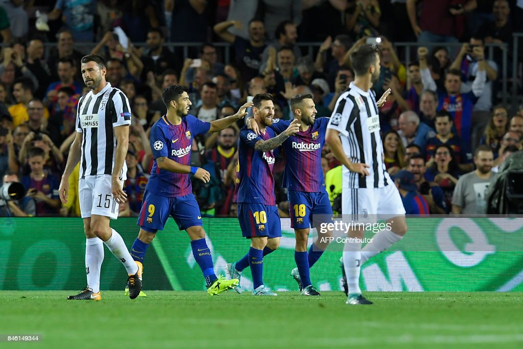 Barcelona's forward from Argentina Lionel Messi (C) celebrates with teammates after scoring during the UEFA Champions League Group D football match FC Barcelona vs Juventus at the Camp Nou stadium in Barcelona on September 12, 2017. /