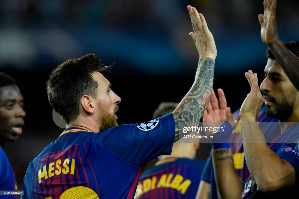 Barcelona's forward from Argentina Lionel Messi (L) celebrates with Barcelona's forward from Uruguay Luis Suarez after scoring during the UEFA Champions League Group D football match FC Barcelona vs Juventus at the Camp Nou stadium in Barcelona on September 12, 2017. /