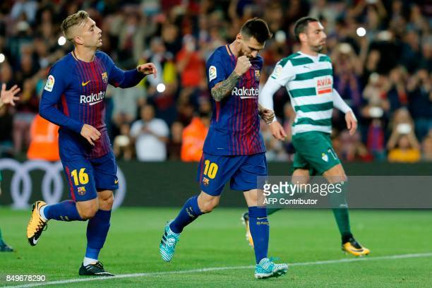 Barcelona's forward from Argentina Lionel Messi celebrates with Barcelona's forward from Spain Gerard Deulofeu after scoring during the Spanish...