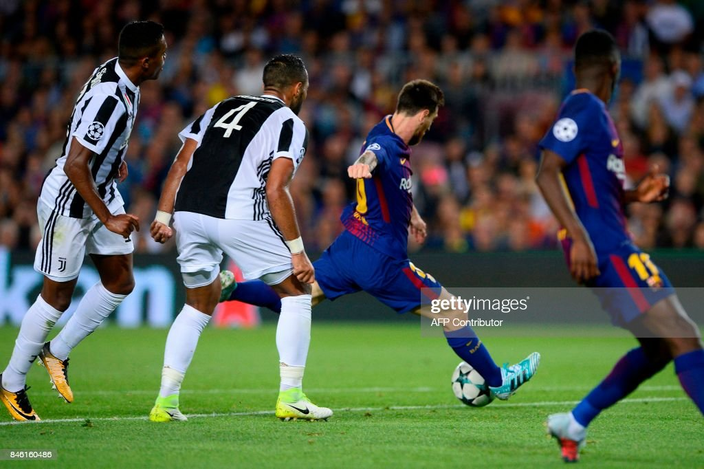 Barcelona's forward from Argentina Lionel Messi kicks to score during the UEFA Champions League Group D football match FC Barcelona vs Juventus at the Camp Nou stadium in Barcelona on September 12, 2017. / AFP PHOTO / Josep LAGO