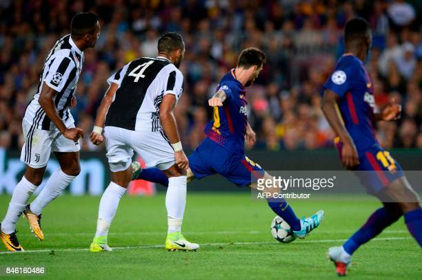 Barcelona's forward from Argentina Lionel Messi kicks to score during the UEFA Champions League Group D football match FC Barcelona vs Juventus at...
