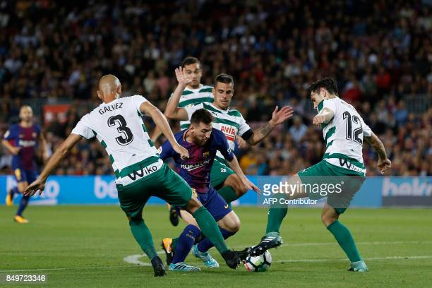 Barcelona's forward from Argentina Lionel Messi vies with Eibar players during the Spanish league football match FC Barcelona against SD Eibar at the...
