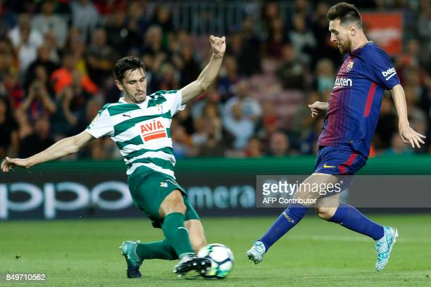 Barcelona's forward from Argentina Lionel Messi vies with Eibar's defender from Spain Alejandro Galvez during the Spanish league football match FC...