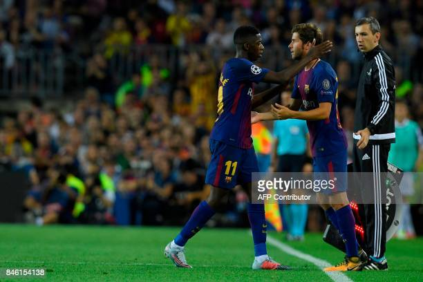 Barcelona's forward from France Ousmane Dembele is substituted by Barcelona's midfielder from Spain Sergi Roberto during the UEFA Champions League...