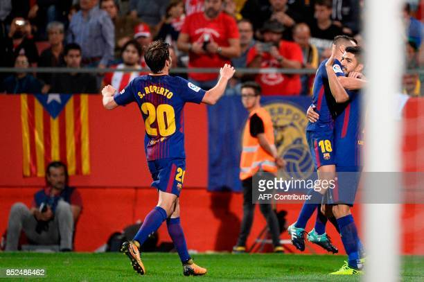 Barcelona's forward from Uruguay Luis Suarez celebrates with Barcelona's defender from Spain Jordi Alba and Barcelona's midfielder from Spain Sergi...