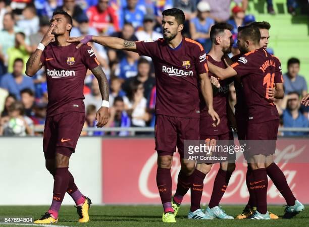 Barcelona's forward from Uruguay Luis Suarez congratulates Barcelona's midfielder from Brazil Paulinho as he celebrates a goal during the Spanish...