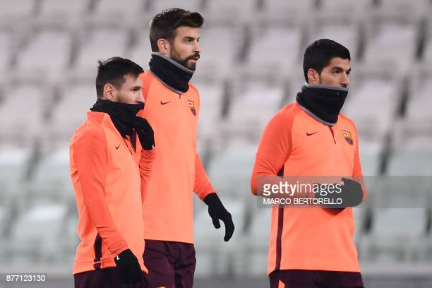 Barcelona's forward Lionel Messi from Argentina Barcelona's defender Gerard Piquet from Spain and Barcelona's forward Luis Suarez from Uruguay attend...