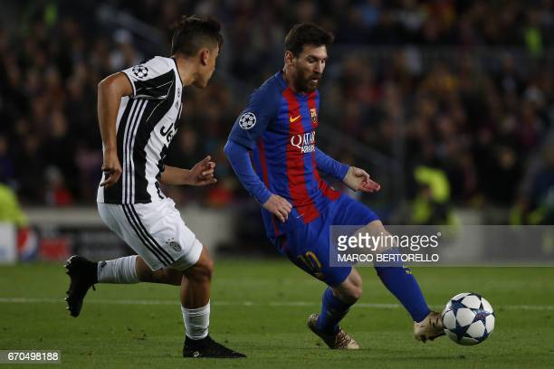 Barcelona's forward Lionel Messi from Argentina fights for the ball with Juventus' forward Paulo Dybala from Argentina during the UEFA Champions...