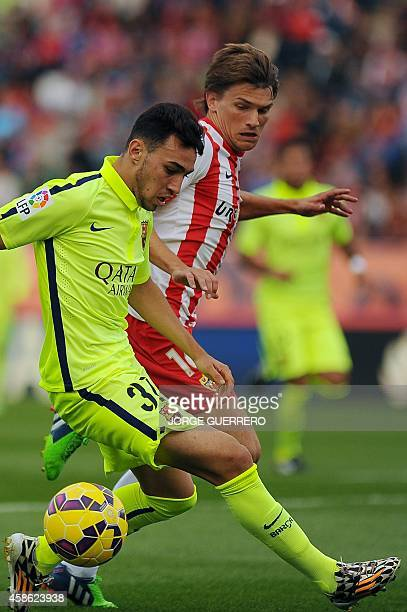 Barcelona's forward Munir Al Hadidi vies for the ball with Almeria's Argentinian midfielder Sebastian Dubarbier during the Spanish league football...