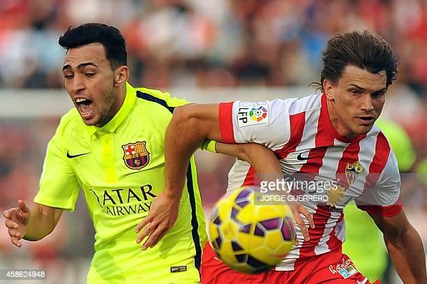 Barcelona's forward Munir Al Hadidi vies for the ball with Almeria's Argentinian midfielder Sebastian Dubarbier during the Spanish league football...