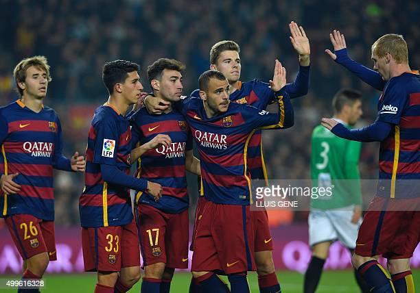 Barcelona's forward Munir El Haddadi celebrates with Barcelona's midfielder Sergi Samper Barcelona's forward Aitor Cantalapiedra Barcelona's forward...