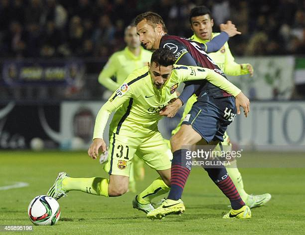 Barcelona's forward Munir vies with Huesca's defender Alex Garcia during the Spanish Copa del Rey round of 32 first leg football match SAD Huesca vs...
