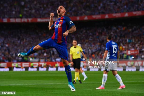 Barcelona's forward Paco Alcacer celebrates after scoring during the Spanish Copa del Rey final football match FC Barcelona vs Deportivo Alaves at...
