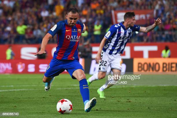 Barcelona's forward Paco Alcacer kicks to score during the Spanish Copa del Rey final football match FC Barcelona vs Deportivo Alaves at the Vicente...