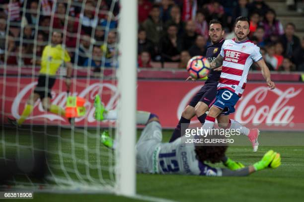 Barcelona's forward Paco Alcacer vies with Granada's Mexican goalkeeper Guillermo Ochoa and defender Hector Hernandez during the Spanish league...