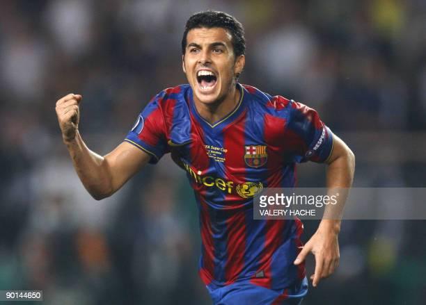 Barcelona's forward Pedro jubilates after scoring a goal during the UEFA SuperCup Europa League football match FC Barcelona vs. FC Shakhtar Donetsk,...