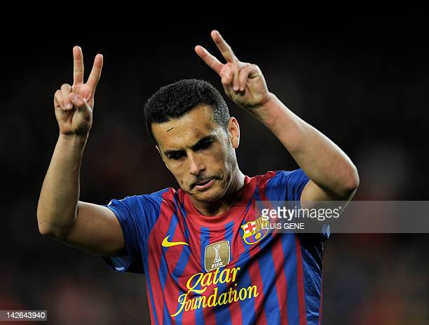 Barcelona's forward Pedro Rodriguez celebrates after scoring a goal during the Spanish league football match FC Barcelona vs Getafe CF on April 10...