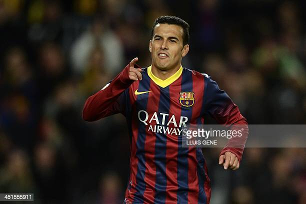 Barcelona's forward Pedro Rodriguez celebrates after scoring during the Spanish league football match FC Barcelona vs CF Granada at the Camp Nou...