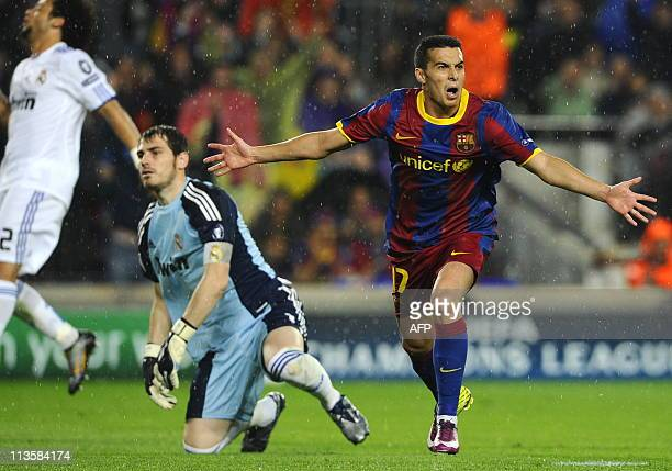 Barcelona's forward Pedro Rodriguez celebrates after scoring next to Real Madrid's goalkeeper and captain Iker Casillas during the Champions League...