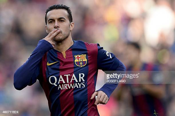 Barcelona's forward Pedro Rodriguez celebrates his goal during the Spanish league football match FC Barcelona vs Cordoba CF at the Camp Nou stadium...